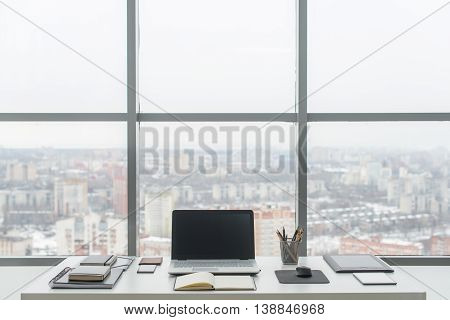 Office. Comfortable work table, workplace with notebook laptop