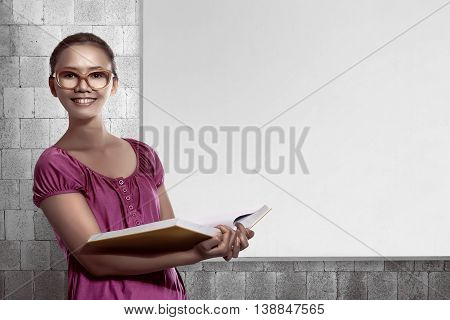 Asian Female Student Carry A Lot Of Books