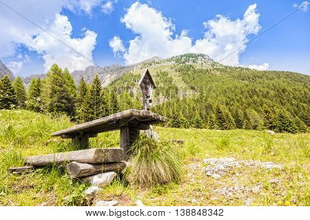 Mountain Panorama With Table And Benches For Resting And Crucified. .