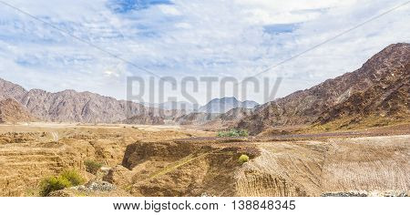 Desert landscape with mountains in the background in the United Aran Emirates