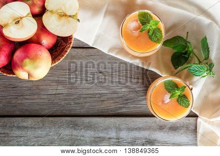 two glasses of fruit smoothies decorated mint