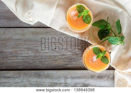 two glasses of fruit smoothies decorated mint copyspace