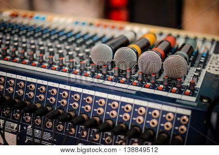 many microphone on the audio mixer. no people