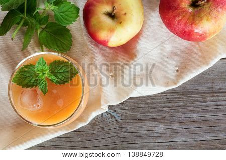 glass of apple smoothie decorated with mint