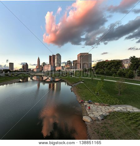 Scioto River and downtown Columbus Ohio skyline at John W. Galbreath Bicentennial Park at dusk