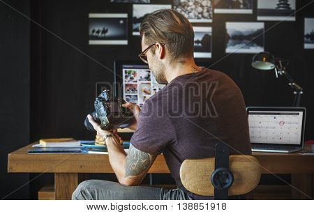Photographer Working Checking Photo Concept