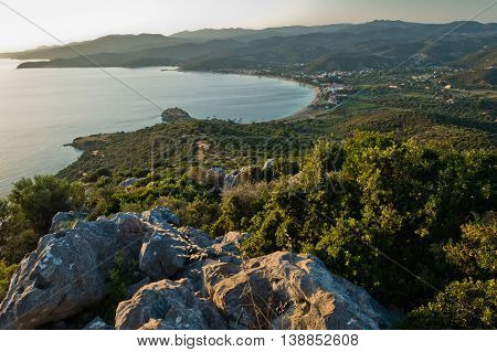 Aerial view of a beach at small greek village Toroni at sunset in Sithonia, Greece