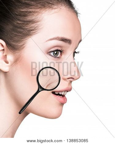 Young woman with magnifying glass showing aging skin isolated on white