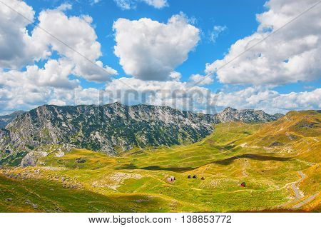 Montenegro national park Durmitor mountains and clouds panorama. Sunlight lanscape. Nature travel background