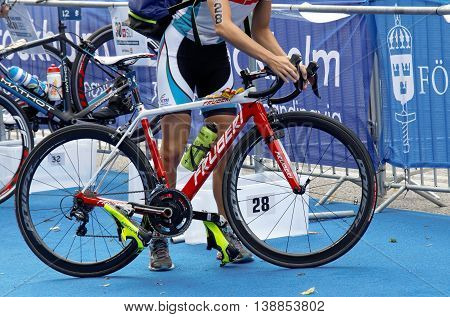 STOCKHOLM - JUL 02 2016: Closeup of a professional triathlete preparing the cycle in the Women's ITU World Triathlon series event July 02 2016 in Stockholm Sweden