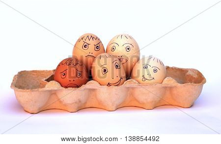 funny chicken eggs in a tray on a white background photo