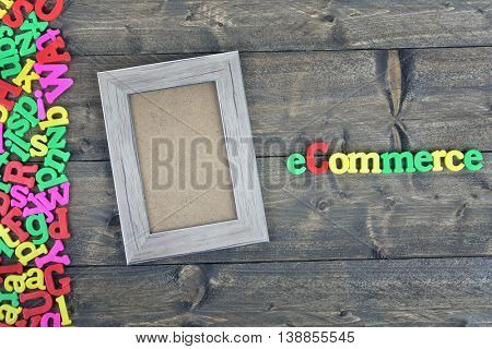 Ecommerce word on wooden table