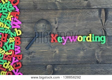 Keywording word on wooden table