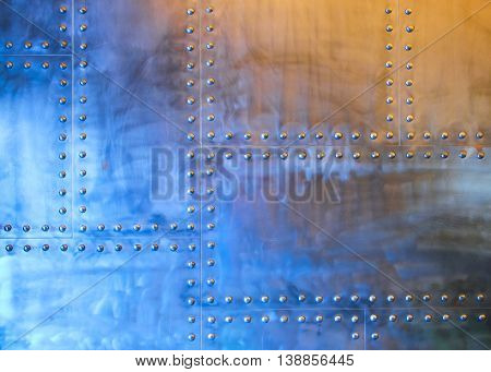 wall with metal plates and studs, abstract background