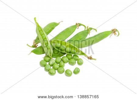 Several fresh green peas shelled from the pods and several pods of a peas on a light background