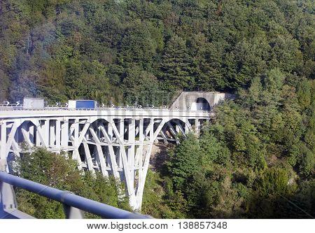 Italy . bridge on the green hill.