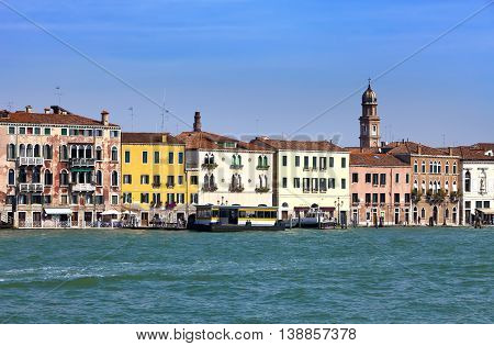 Venice. Italy. Bright ancient houses lengthways Canal Grande
