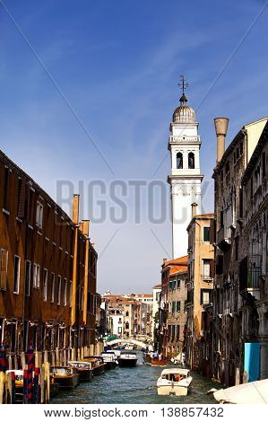 Ancient buildings on coast of the narrow channel. Venice Italy.