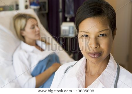 Doctor Standing In Her Patients Room