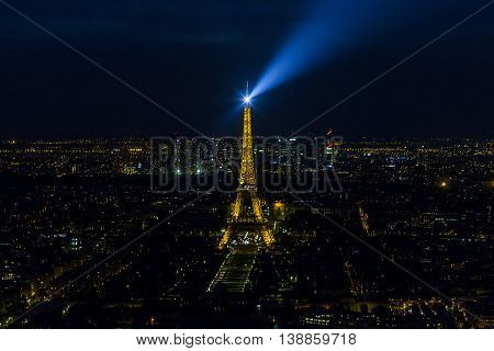 PARIS, FRANCE - MAY 11, 2015: It is a night aerial view of Paris and the Eiffel Tower.