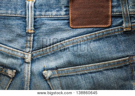 Denim jeans back pocket with blank leather tag