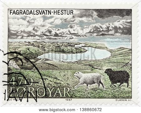 LUGA RUSSIA - JUNE 25 2016: A stamp printed by FAROE ISLANDS shows two domestic sheeps from Hestur. Hestur - an island in the central Faroe Islands circa 1987.