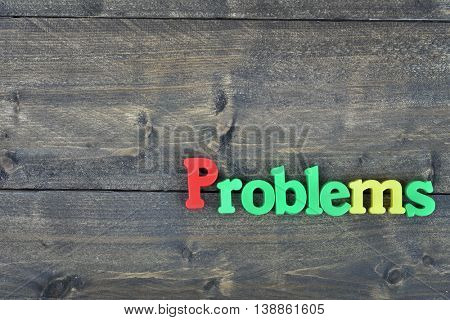 Problems word on wooden table