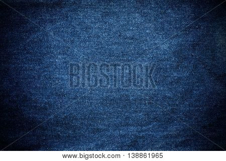 Denim jeans texture background, with vignette border