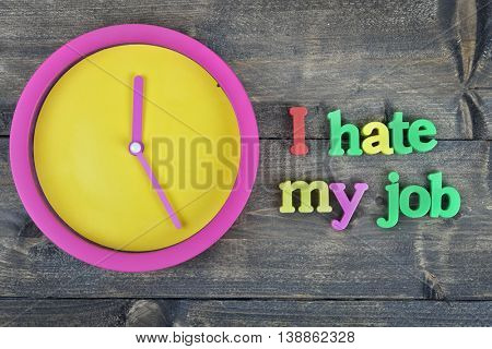 I hate my job word on wooden table