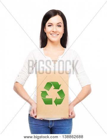 Eco, recycling, and a world saving concept. Woman with a paper bag with ecology symbol.