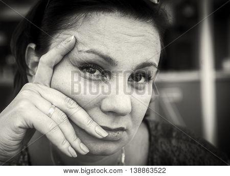 Very sad mature woman. Black and white photo