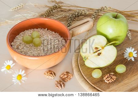 Health cereals breakfast with apples and spikelets