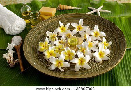 Spa set on banana leaf with frangipani in bowl