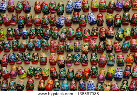 Russia Moscow - June 24 2015: Colorful russian nesting dolls matryoshka in the form of magnets at market on the Arbat. Matryoshka Babushka Are Most Popular Souvenir From Russia.