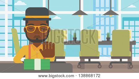 An african-american young businessman sitting at the table in office and moving dollar bills away. Vector flat design illustration. Horizontal layout.