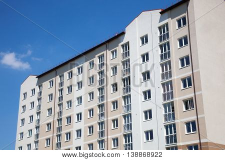 Part of the Apartment Buildings. Blue Sky.