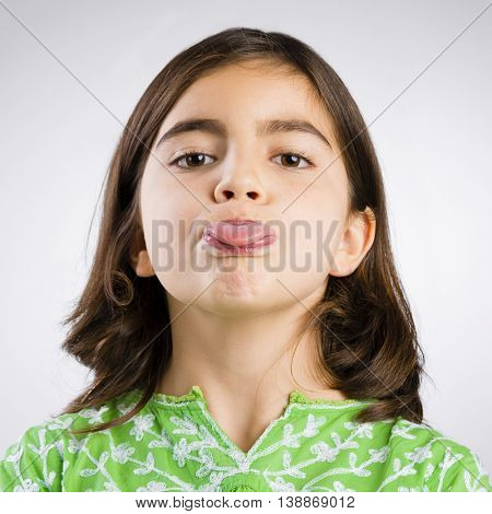 Portrait of a little girl making a funny expression