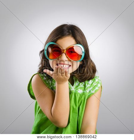 Portrait of a happy young girl wearing funny sunglasses