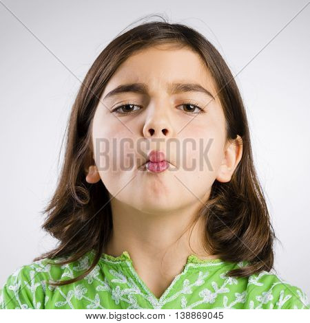 Portrait of a little girl making a fish mouth expression