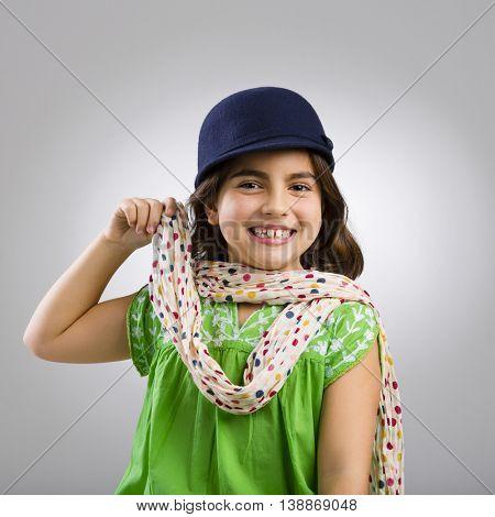 Studio portrait of a beautiful little girl smiling