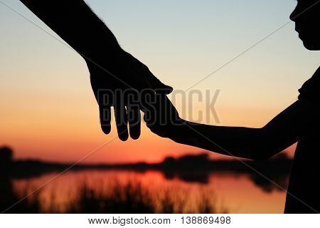 a nice silhouette parent and child hands
