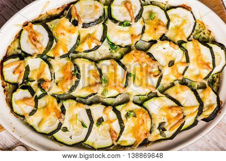 Casserole With Zucchini, Cheese And Fresh Basil In Baking Dish