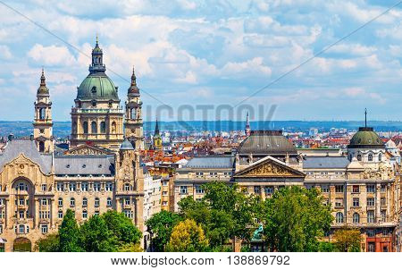 Urban landscape panorama with old buildings and domes of opera in budapest hungary