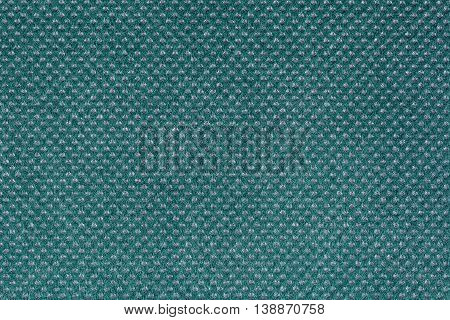 Turquoise fabric with round grey inclusions, close up