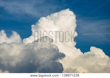 Blue sky background with scenic fluffy clouds