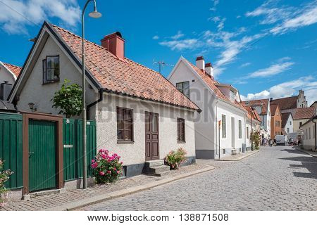 VISBY, SWEDEN - JULY 8, 2016: Medieval street in Visby. Visby is a historic Hanse town and a major tourist destination on Swedish Baltic sea island Gotland.