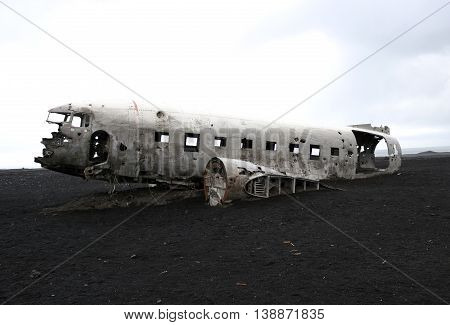 wreck of old military plane on the gray desert landscape