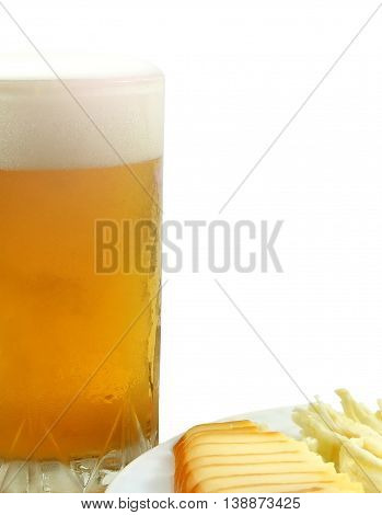 Glass with light beer next to plate of cheese, fragment. Macro, isolated on white background. Photos in art