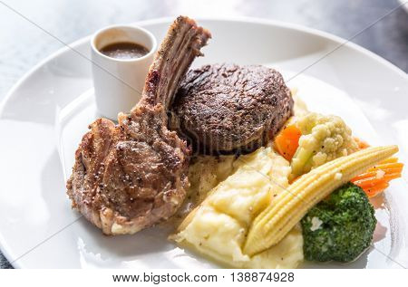 Grilled Lamb steak with mashed potato and vegetable