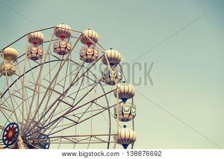 Ferris wheel on sky background retro effect image